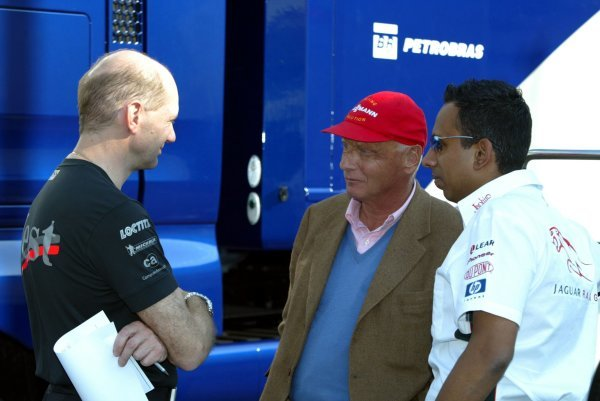 (L to R): Adrian Newey (GBR) McLaren Technical Director chats with Former Jaguar Team Boss Niki Lauda (AUT) and Nav Sidhu (GBR) Jaguar PR Manager.