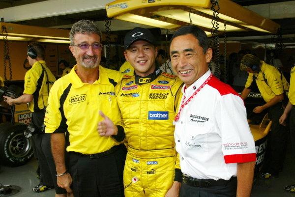 (L to R): Eddie Jordan (IRE) Jordan Team Principal with Satoshi Motoyama (JPN) Jordan and Hiroshi Yasukawa (JPN) Bridgestone Director of Motorsport.Formula One World Championship, Rd16, Japanese Grand Prix, Suzuka , Japan, 10 October 2003.DIGITAL IMAGE