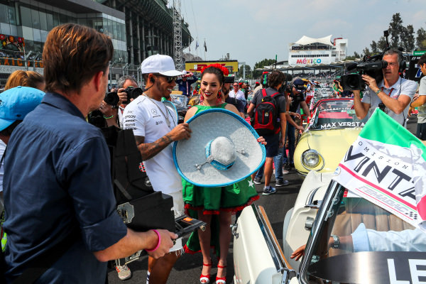 Lewis Hamilton (GBR) Mercedes AMG F1 with grid girl and Sombrero hat on the drivers parade at Formula One World Championship, Rd18, Mexican Grand Prix, Race, Circuit Hermanos Rodriguez, Mexico City, Mexico, Sunday 29 October 2017.