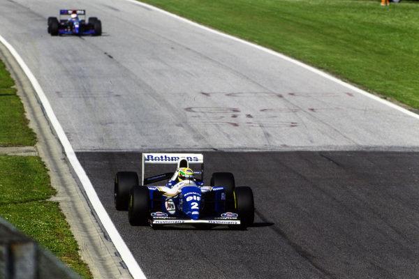 Ayrton Senna, Williams FW16 Renault, leads Roland Ratzenberger, Simtek S941 Ford.