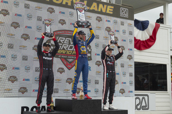 Victory Podium: 2nd Place - Will Power, Team Penske Chevrolet (L), 1st Place - Alexander Rossi, Andretti Autosport Honda (C), and 3rd Place - Josef Newgarden, Team Penske Chevrolet (R)