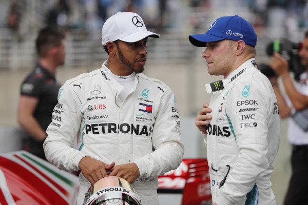 Lewis Hamilton, Mercedes AMG F1, celebrates taking pole position, alongside Valtteri Bottas, Mercedes AMG F1.