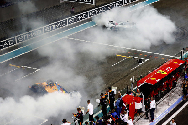 Fernando Alonso, McLaren MCL33, and Lewis Hamilton, Mercedes AMG F1 W09 EQ Power+, perform doughnuts on the grid at the end of the race