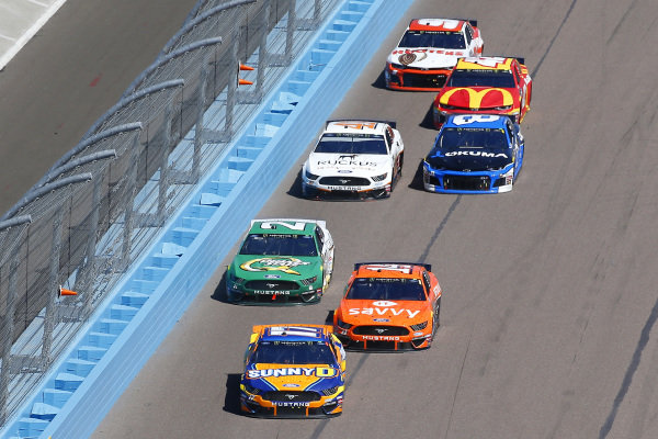 #17: Ricky Stenhouse Jr., Roush Fenway Racing, Ford Mustang SunnyD, #14: Clint Bowyer, Stewart-Haas Racing, Ford Mustang ITsavvy and #21: Paul Menard, Wood Brothers Racing, Ford Mustang Menards / Quaker State