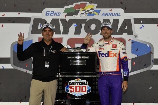 #11: Denny Hamlin, Joe Gibbs Racing, Toyota Camry FedEx Express, celebrates in victory Lane after winning the Daytona 500.