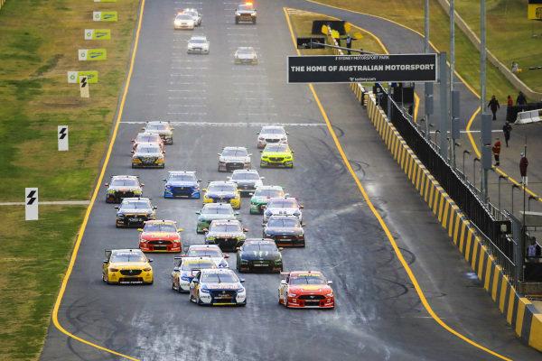 Shane van Gisbergen, Triple Eight Engineering Holden, and Scott McLaughlin, DJR Team Penske Ford at the start of the race