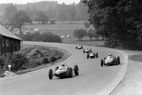 Giancarlo Baghetti (ITA) Ferrari 156, who retired early with faulty ignition wiring, leads seventh place finisher Carel Godin de Beaufort (NED) Porsche 718, ninth place finisher Lucien Bianchi (BEL) Lotus 18/21, eighth placed Maurice Trintignant Rob Walker Lotus 24 and Jo Siffert (SUI) Lotus 21 who finished tenth on his Grand Prix race.  Belgian Grand Prix, Spa-Francorchamps, 17 June 1962.