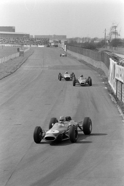Jack Brabham, Brabham BT7 Climax, leads Graham Hill, BRM P261, and Bruce McLaren, Cooper T73 Climax.