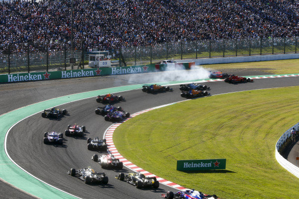 Max Verstappen, Red Bull Racing RB15 spins after making contact with Charles Leclerc, Ferrari SF90
