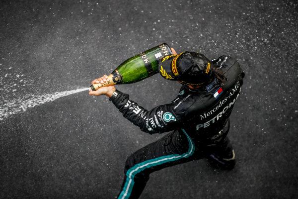 Lewis Hamilton, Mercedes-AMG Petronas F1, 1st position, celebrates on the podium with champagne