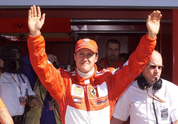 2001 American Grand Prix - QualifyingIndianapolis, United States. 29th September 2001.Michael Schumacher, Ferrari F2001, celebrates taking pole position.World Copyright: Steve Etherington/LAT Photographicref: 18mb Digital Image