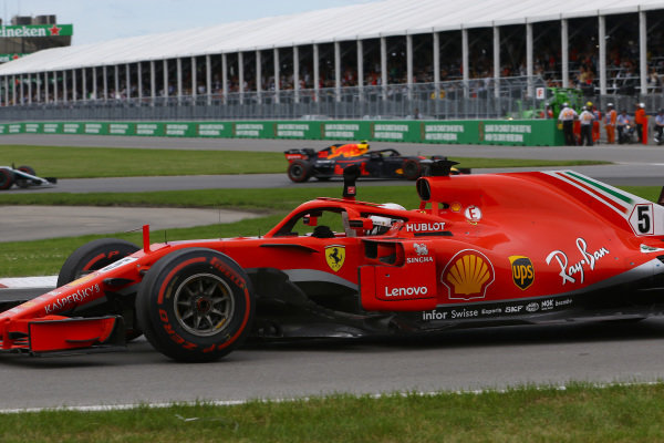 Race winner Sebastian Vettel (GER) Ferrari SF-71H waves at the end of the race ..