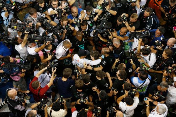 Yas Marina Circuit, Abu Dhabi, United Arab Emirates. Sunday 23 November 2014. Lewis Hamilton, Mercedes AMG, 1st Position, celebrates with his team. World Copyright: Charles Coates/LAT Photographic. ref: Digital Image _J5R7471