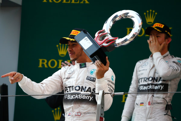 Shanghai International Circuit, Shanghai, China. Sunday 12 April 2015. Lewis Hamilton, Mercedes AMG, 1st Position, on the podium with his trophy. World Copyright: Andrew Hone/LAT Photographic. ref: Digital Image _ONZ1233