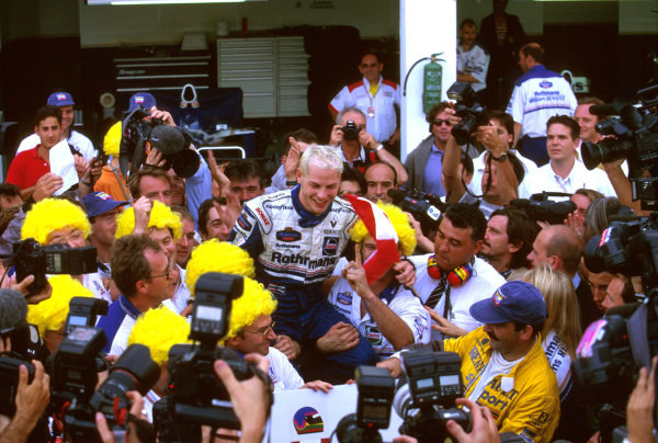 Jerez, Spain.24-26 October 1997.Jacques Villeneuve and his Williams crew celebrate taking the Drivers World Championship title. Ref-97 EUR 06.World Copyright - LAT Photographic
