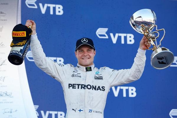 Sochi Autodrom, Sochi, Russia. Sunday 30 April 2017. Valtteri Bottas, Mercedes AMG, 1st Position, with his trophy and Champagne. World Copyright: Steve Etherington/LAT Images ref: Digital Image SNE18803