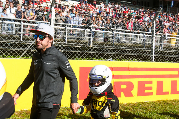 Circuit de Catalunya, Barcelona, Spain. Thursday 11 May 2017. Fernando Alonso, McLaren, with a young Karter. World Copyright: Dom Romney/LAT Images ref: Digital Image AM1T9936