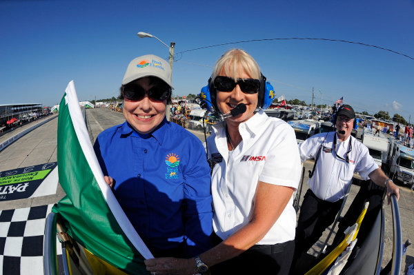 12-15 March, 2014, Sebring, Florida, USA The honorary starter and the IMSA flagwoman after the start. ©2014, F. Peirce Williams LAT Photo USA