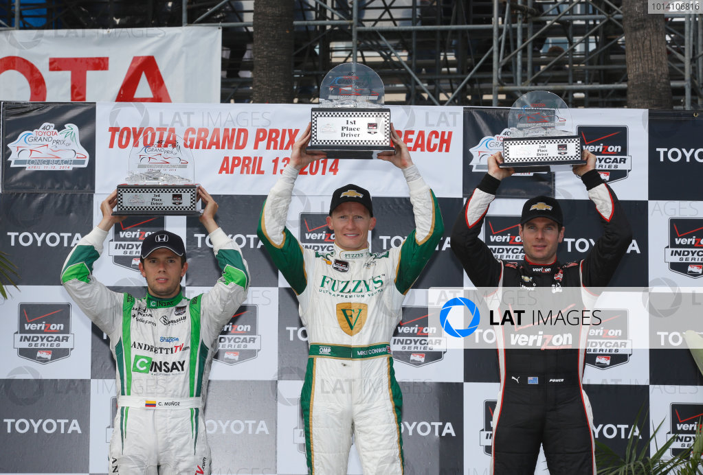 11-13 April, 2014, Long Beach, California USA Mike Conway, Will Power and Carlos Munoz celebrate on the podium ©2014, Michael Levitt LAT Photo USA