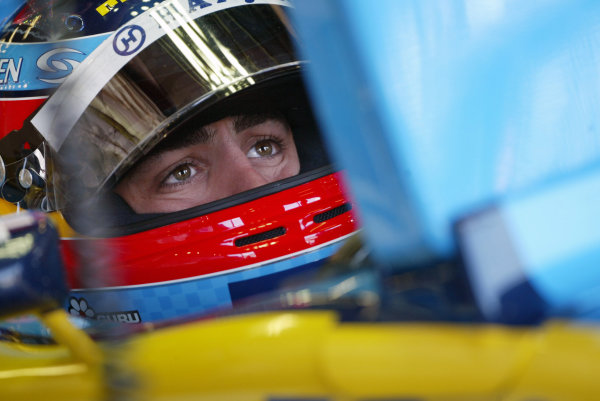 2004 United States Grand Prix - Friday Practice,Indianapolis, USA. 18th June 2004.Fernando Alonso, Renault R24, studies practice times from the cockpit of his car.World Copyright: Steve Etherington/LAT Photographic ref: Digital Image Only