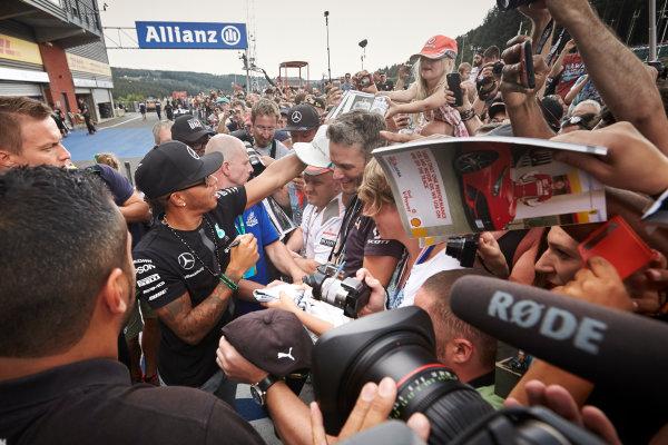 Spa-Francorchamps, Spa, Belgium. Thursday 20 August 2015. Lewis Hamilton, Mercedes AMG, signs autographs for fans. World Copyright: Steve Etherington/LAT Photographic ref: Digital Image SNE14950