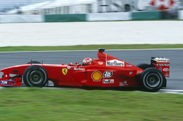 Sepang, Kuala Lumpur, Malaysia. 15-17 October 1999. Eddie Irvine (Ferrari F399). Action. He finished in 1st position. Ref: 99MAL03. World Copyright - LAT Photographic