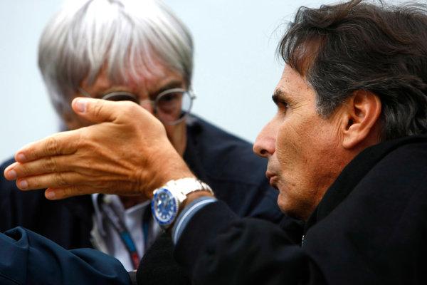 Interlagos, Sao Paulo, Brazil.16th October 2009.Bernie Ecclestone with Nelson Piquet. Portrait. World Copyright: Charles Coates/LAT Photographicref: Digital Image _26Y9537
