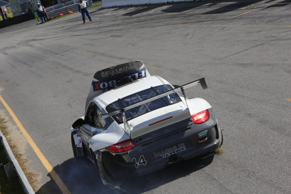 27-28 September, 2013, Lakeville, Connecticut USA The #44 Porsche of Andy Lally and John Potter returns to the pits after a first lap crash. ©2013, R.D. Ethan LAT Photo USA