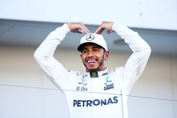 Suzuka Circuit, Japan. Sunday 8 October 2017. Lewis Hamilton, Mercedes AMG, 1st Position, celebrates on the podium with the Mobot. World Copyright: Charles Coates/LAT Images  ref: Digital Image DJ5R1691