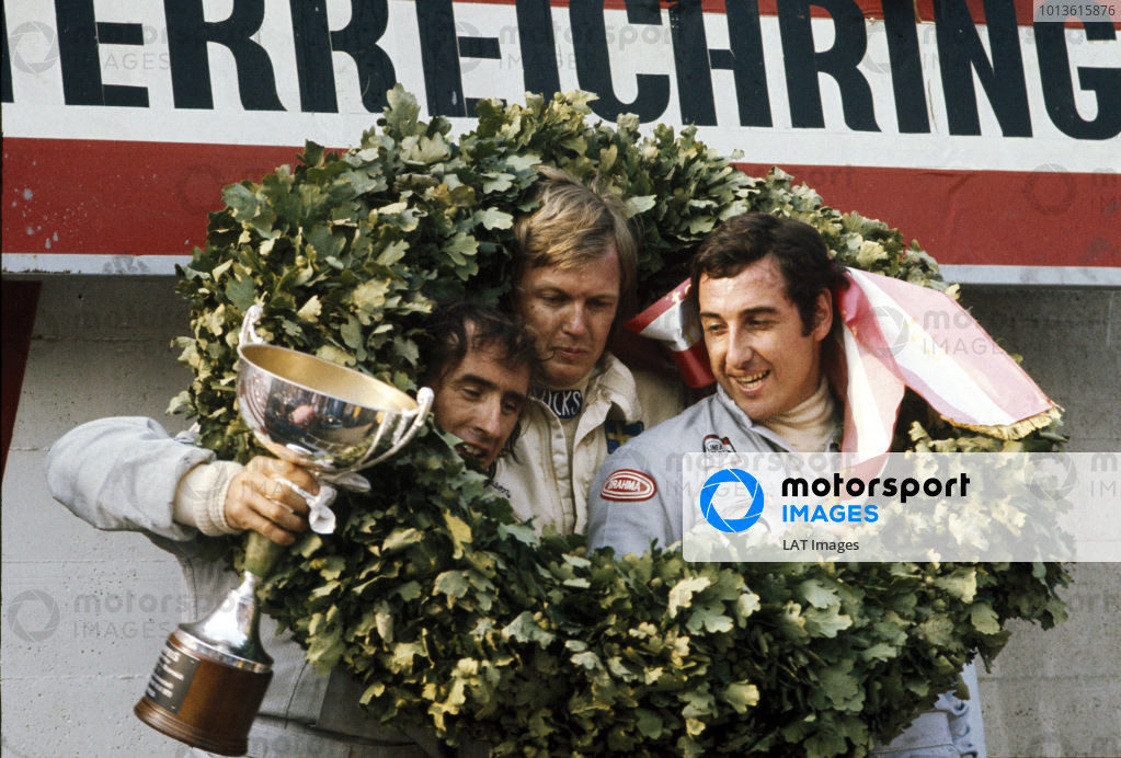 1973 Austrian Grand Prix.  Osterreichring, Zeltweg, Austria. 17-19th October 1973.  Ronnie Peterson, Lotus, 1st position, with Jackie Stewart, Tyrrell, 2nd position and Carlos Pace, Surtees, 3rd position, on the podium.  Ref: 72AUT05. World Copyright: LAT Photographic