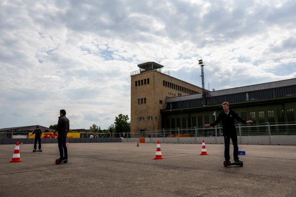 2014/2015 FIA Formula E Championship. Berlin ePrix, Berlin Tempelhof Airport, Germany. Thursday 21 May 2015 Jerome D'Ambrosio (BEL)/Dragon Racing - Spark-Renault SRT_01E, Nelson Piquet Jr (BRA)/China Racing - Spark-Renault SRT_01E and Scott Speed (USA)/Andretti Autosport - Spark-Renault SRT_01E on hovertrax. Photo: Zak Mauger/LAT/Formula E ref: Digital Image _L0U6543