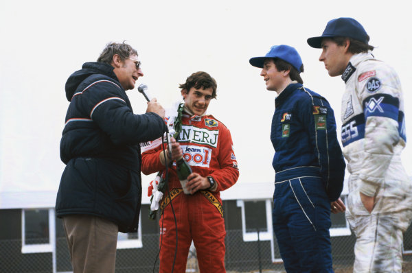 Silverstone, Great Britain. 20th March 1983.  Ayrton Senna (Ralt RT3-Toyota), 1st position, with Martin Brundle (Ralt RT3-Toyota), 2nd position and Mario Hytten (Ralt RT3-Toyota), 3rd position, are interviewed on the podium, portrait.  World Copyright: LAT Photographic