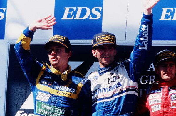1995 Australian Grand Prix. Adelaide, Australia. 10-12 November 1995. Damon Hill (Williams Renault) 1st position, Olivier Panis (Ligier Mugen-Honda) 2nd position and Gianni Morbidelli (Footwork Hart) 3rd position on the podium. Ref-95 AUS 13. World Copyright - LAT Photographic