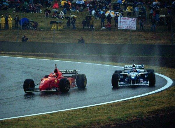 1996 Spanish Grand Prix.Catalunya, Barcelona, Spain.31/5-2/6 1996.Michael Schumacher (Ferrari F310) leads Jacques Villeneuve (Williams FW18-Renault). Schumacher finished in 1st position.World Copyright - LAT Photographic