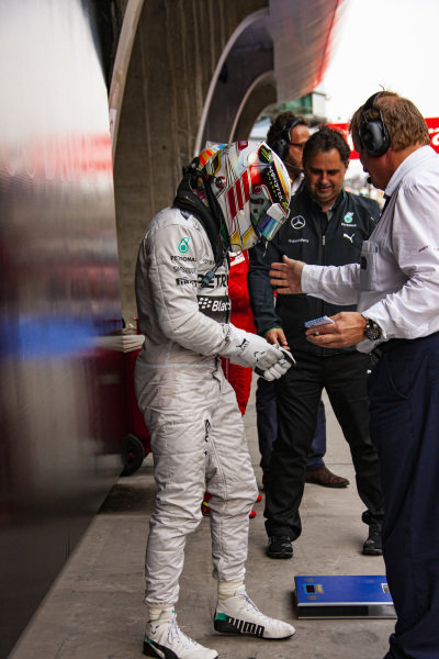 Lewis Hamilton is weighed in Parc Ferme.