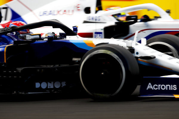 George Russell, Williams FW43B, passes Mick Schumacher, Haas VF-21