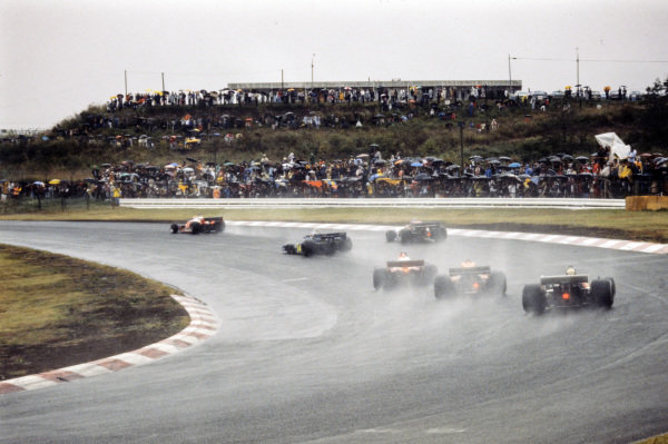 Clay Regazzoni, Ferrari 312T2 leads Patrick Depailler, Tyrrell P34 Ford, Ronnie Peterson, March 761 Ford, and Niki Lauda, Ferrari 312T2. Kazuyoshi Hoshino, Tyrrell 007 Ford, brings up the rear.