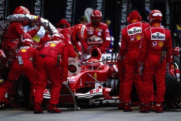 Michael Schumacher, Ferrari F2004, during a pitstop.