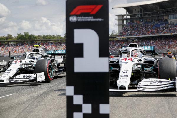 Pole sitter Lewis Hamilton, Mercedes AMG F1 W10 and Valtteri Bottas, Mercedes AMG W10 drive into Parc Ferme
