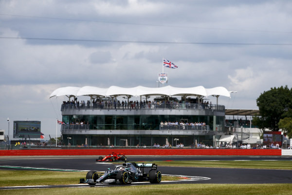 Lewis Hamilton, Mercedes AMG F1 W10 and Sebastian Vettel, Ferrari SF90