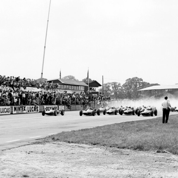 1963 British Grand Prix. Silverstone, England. 18-20 July 1963. Jim Clark (Lotus 25 Climax), Dan Gurney (Brabham BT7 Climax), Graham Hill (BRM P57) and Jack Brabham (Brabham BT7 Climax) lead off the grid. Ref-20420. World Copyright - LAT Photographic
