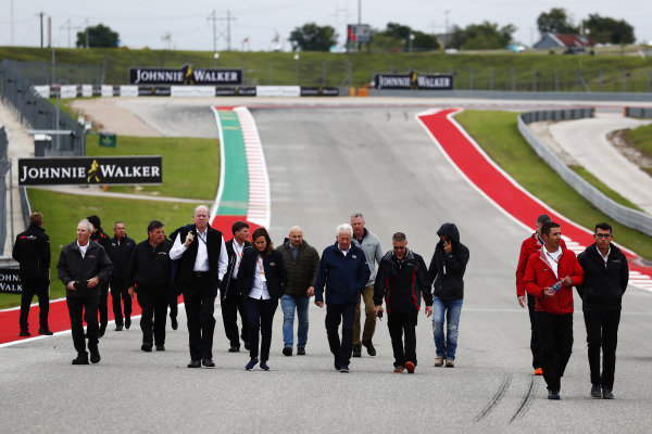 Charlie Whiting, Race Director, FIA, walks the track with his team