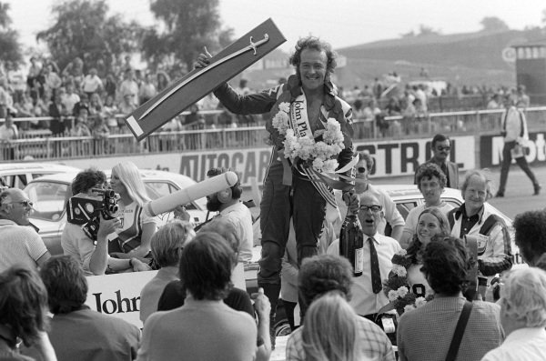 Paul Smart holds his sword aloft after winning the race.