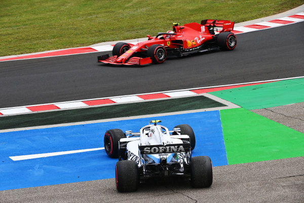Charles Leclerc, Ferrari SF1000, passes as Nicholas Latifi, Williams FW43, recovers from a spin