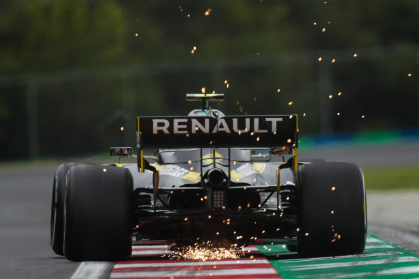 Sparks fly from the rear of Esteban Ocon, Renault R.S.20