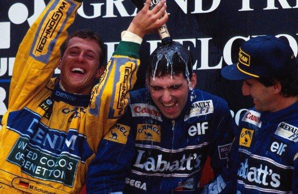 Celebrations on the podium (L to R): Michael Schumacher (GER) Benetton second; Damon Hill (GBR) Williams winner; Alain Prost (FRA) Williams third.  Belgian Grand Prix, Spa-Francorchamps, 29 August 1993.