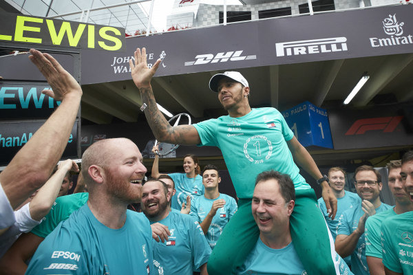 Lewis Hamilton, Mercedes AMG F1, on the shoulders of Ron Meadows, Sporting Director, Mercedes AMG, celebrates with the Mercedes team
