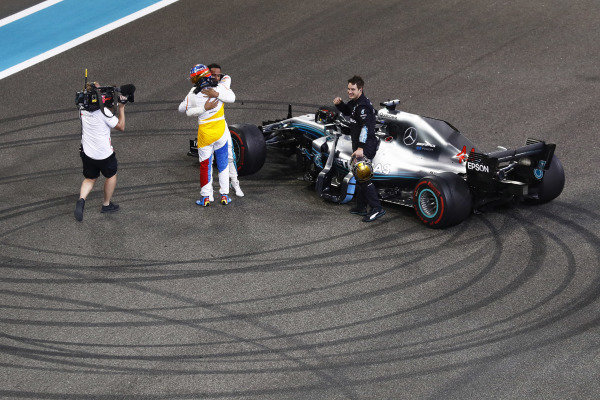 Fernando Alonso, McLaren, embraces Lewis Hamilton, Mercedes AMG F1 W09 EQ Power+, at the end of the race