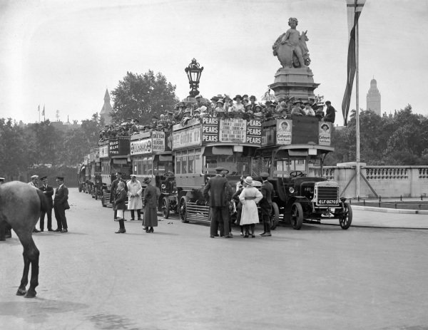 Crowds gather on buses in London during Peace Day celebrations.