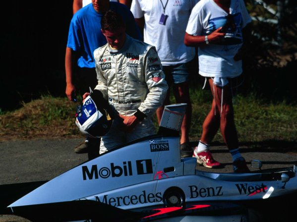 1997 Hungarian Grand Prix.Hungaroring, Budapest, Hungary.8-10 August 1997.David Coulthard (McLaren MP4/12 Mercedes-Benz) retires.World Copyright - Tee/LAT Photographic